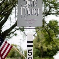 Stone Manor Country Club Sign Entrance USA Flag